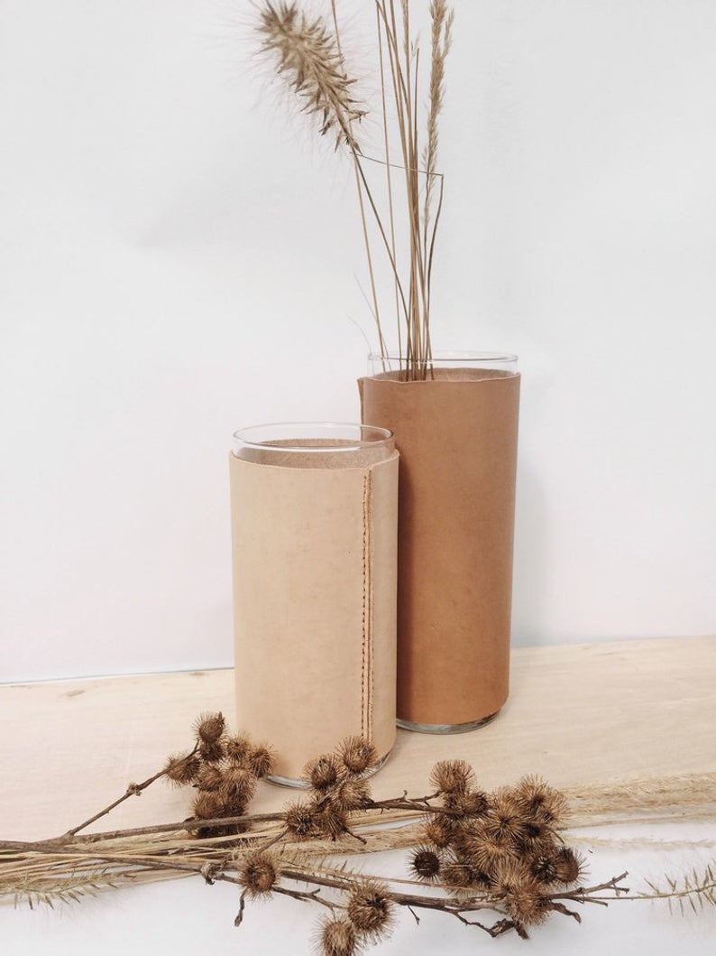 Affordable and cool, these leather wrapped vases will bring warmth to your home this fall. Sharp + Grey's September Favorites.