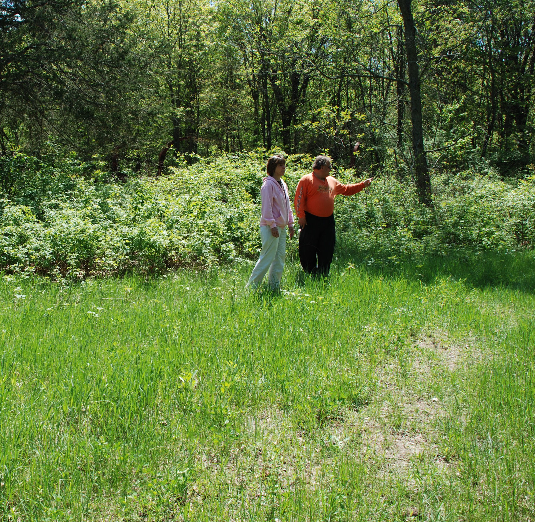 Bev Vaillancourt and Jay Toth, then Archeologist for the Ho-Chunk Nation, discuss the possibility of this being the original location of Yellow Thunder's village.