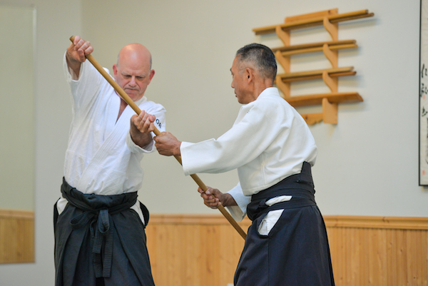Rob working with Sawa Sensei to demonstrate a staff (jo) disarming technique.