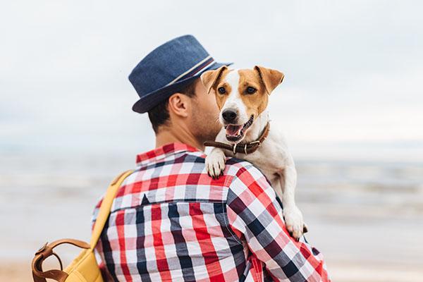 bigstock_man_with_dog_crop 600 223254076.jpg
