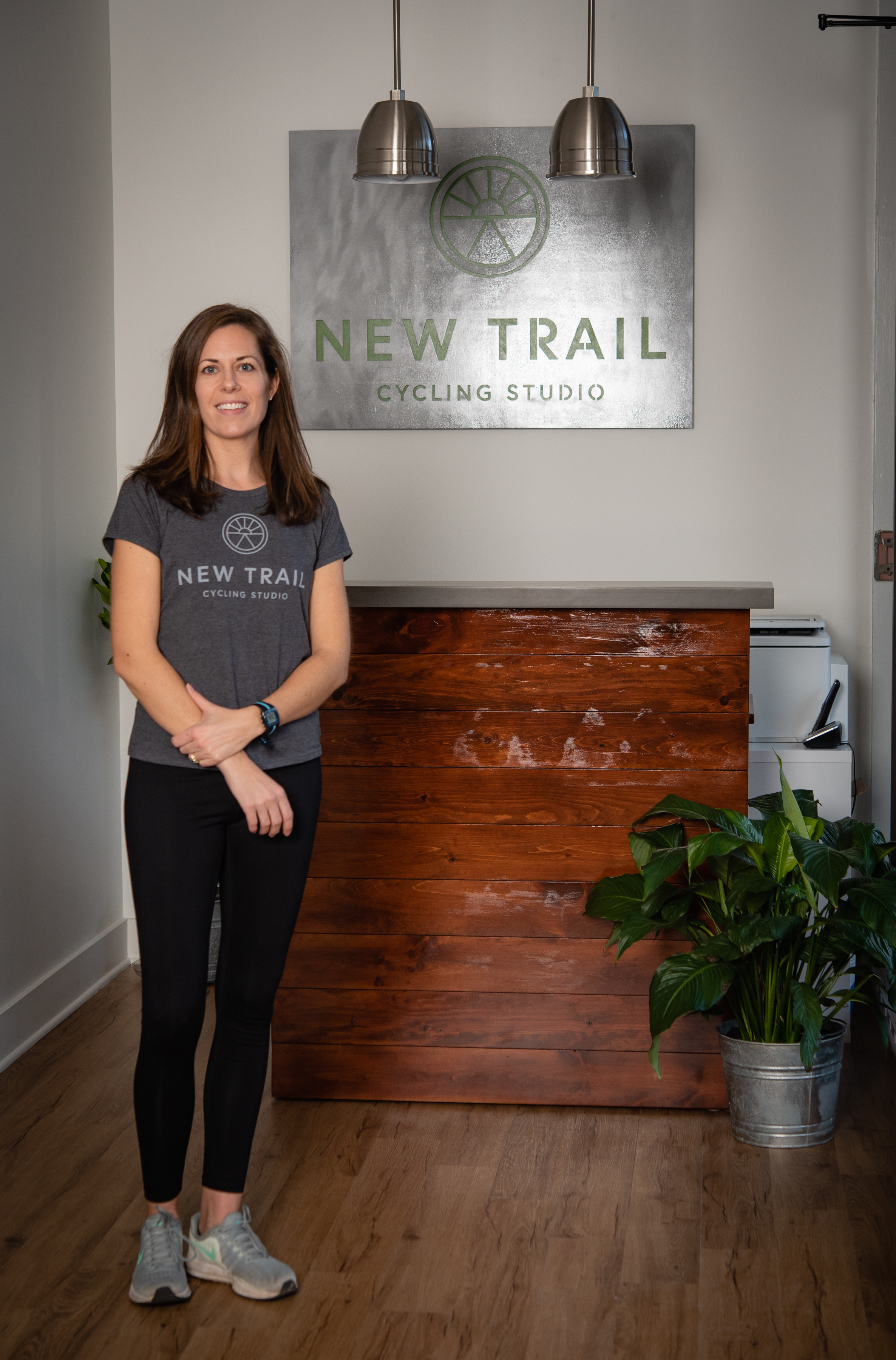 About the Founder - Liz Kamp - I've been teaching, training and/or managing fitness facilities and programs since 2003. Through the years, I've successfully coached many types of clients: those dealing with injuries, new moms trying get back to a fitness routine, people struggling to motivate to exercise, even athletes trying to take it up a notch. I have dealt with each of these issues myself, and cycling has always been an outlet where I can focus on myself, feeling my best, and achieving my personal goals. At New Trail, people come to have fun while they get in shape, work toward fitness goals, and feel a sense of community – we're all on this trail together.As a Reston resident for more than a decade, I'm thrilled to be a member of the growing group of diverse and talented merchants at Lake Anne.Welcome to New Trail, I hope you find a home riding with us.