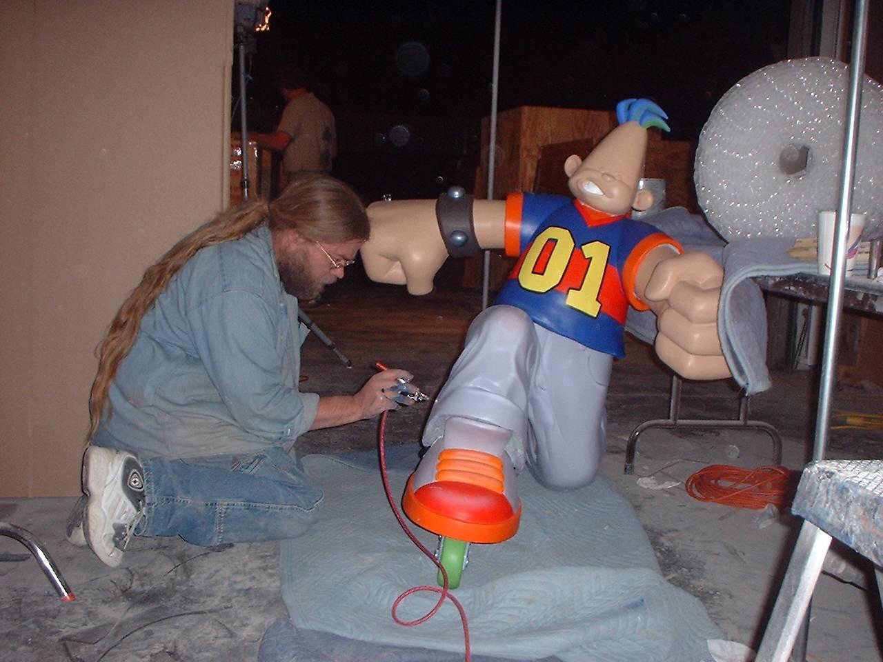 Walt painting a Flamehead character