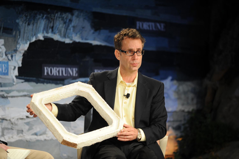 Oliver Campbell holding up mushroom based packaging for Dell servers