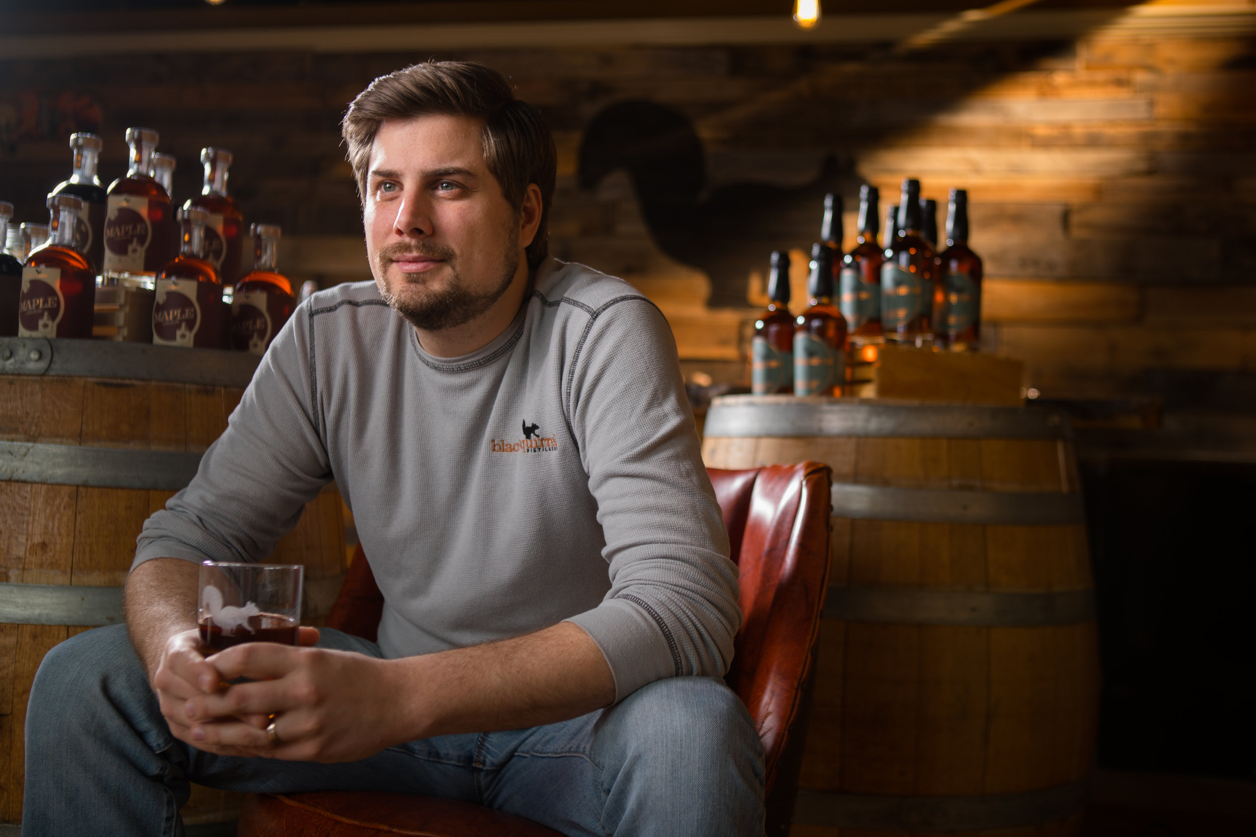 Environmental portrait of Matt Pelkey, of Black Squirrel Distillery in Buffalo, NY.
