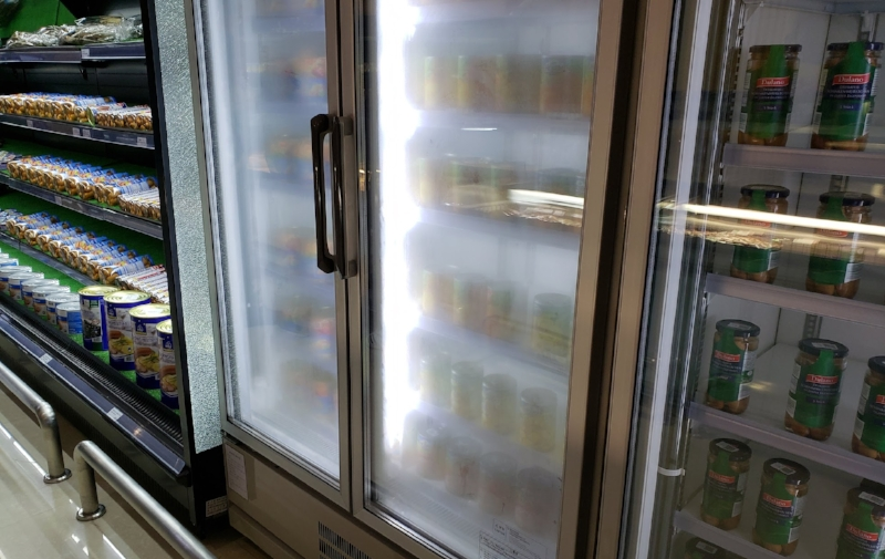 Canned Food in a Freezer. They clearly didn't know what the display freezer was for.
