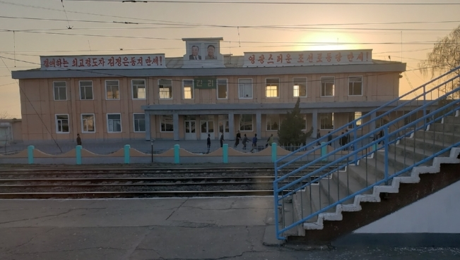 Playing volleyball at sunset at the outside the train station