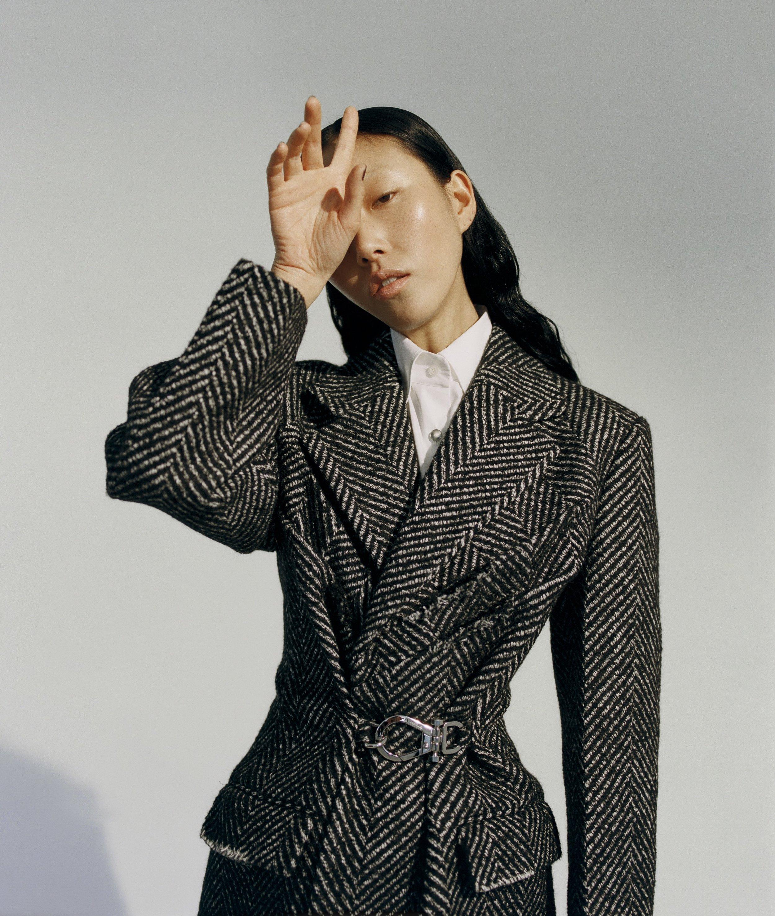 Lim Lee wears PRADA shirt and coat