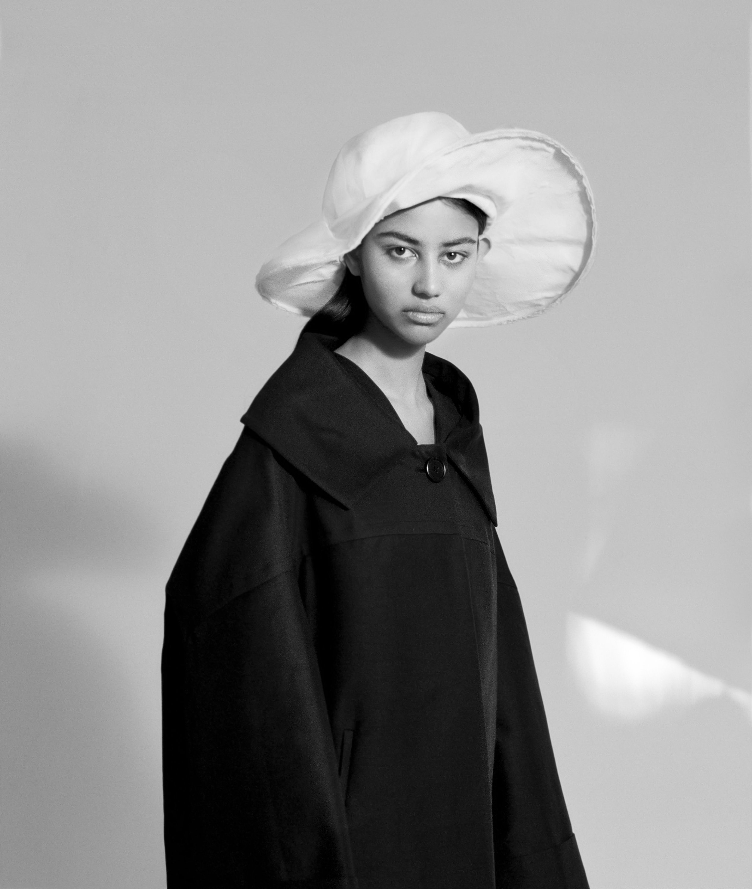 Varsha wears Marni coat and hat     Photography by  Daphne Nguyen   Styling by  Miguel Urbina Tan   Beauty by  Claire Thomson   Hair by  Joel Foreman   Models: Varsha and Lim Lee @ Chadwick Models