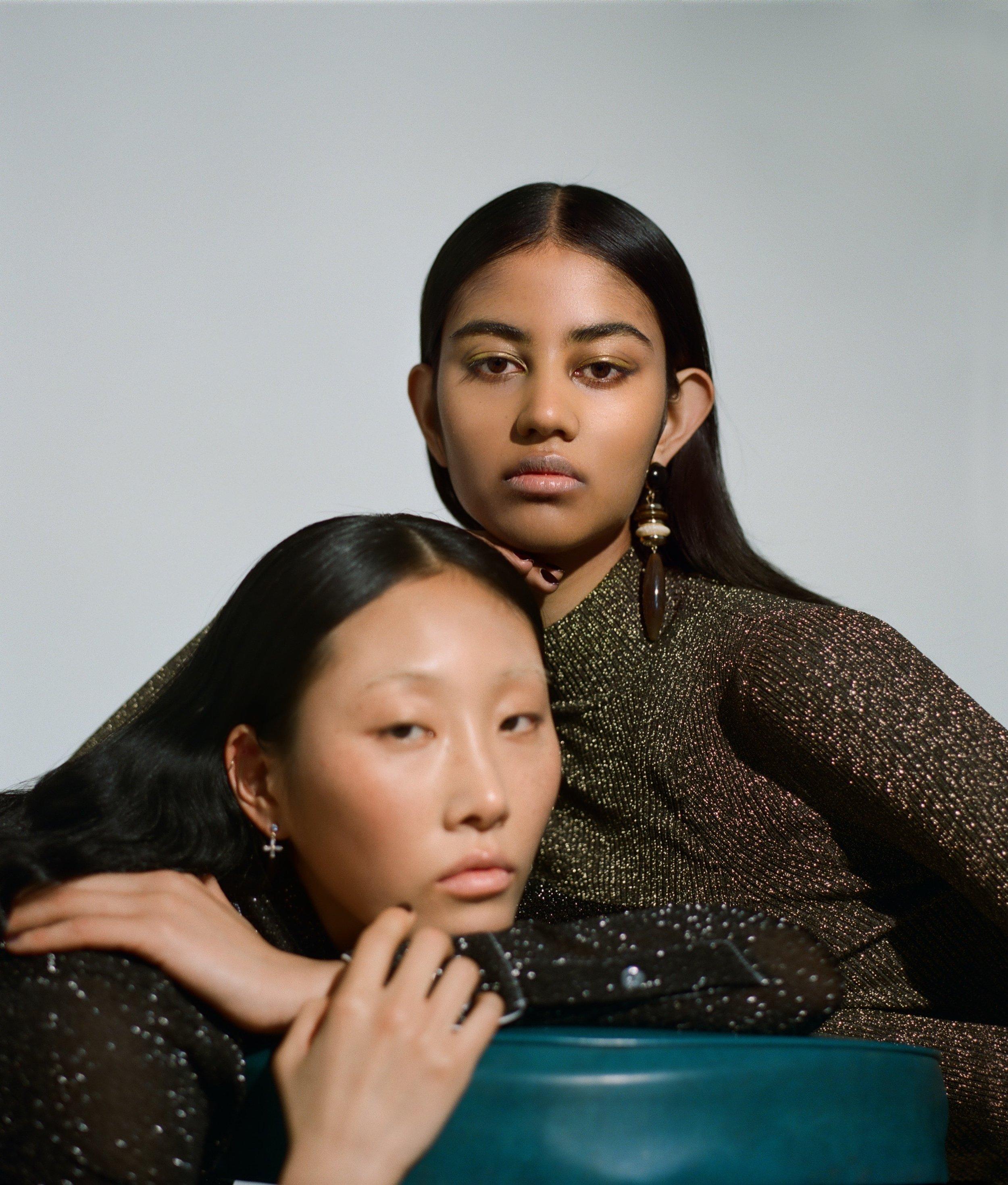 Lim Lee wears Acne Studios, Varsha wears Sandro top, both wear Reliquia earrings