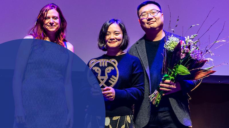 Susanna Nicchiarelli, jury member, hands out the 2019 IFFR Tiger Award to filmmaker Zhu Shengze and her producer Zhengfang Yang