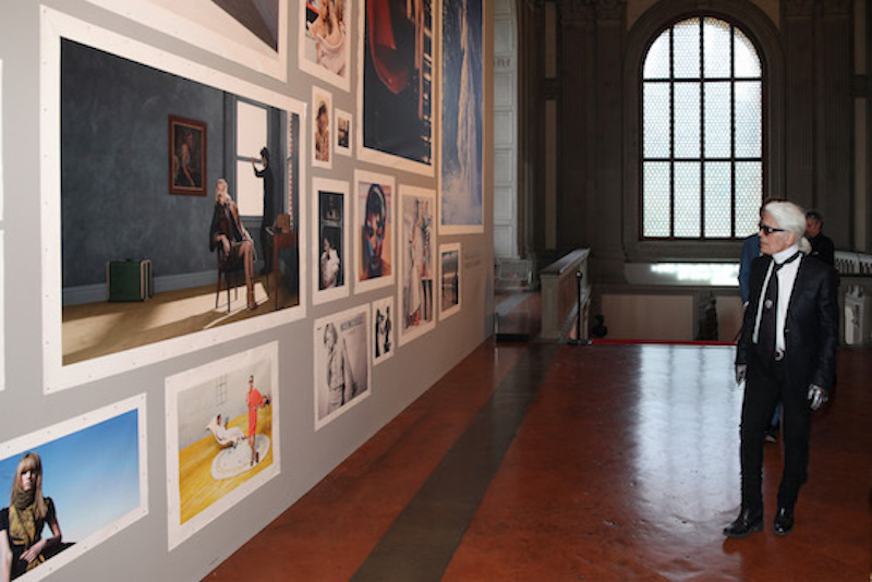 Lagerfeld inside the Pitti Palace, walking through his exhibit in June 2016
