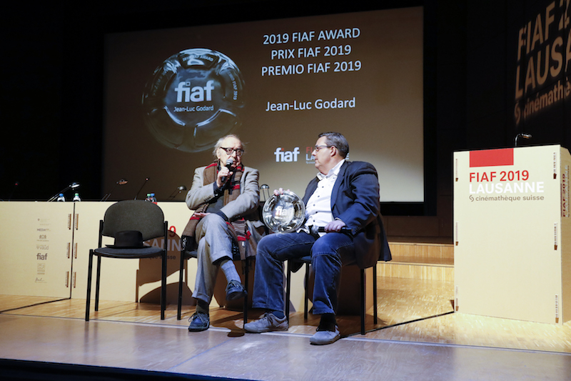 ean-Luc Godard (left) accepts the 2019 FIAF Award from Frédéric Maire, President of FIAF (right) , Lausanne, April 11, 2019, photo by © Carine Roth / Cinémathèque suisse