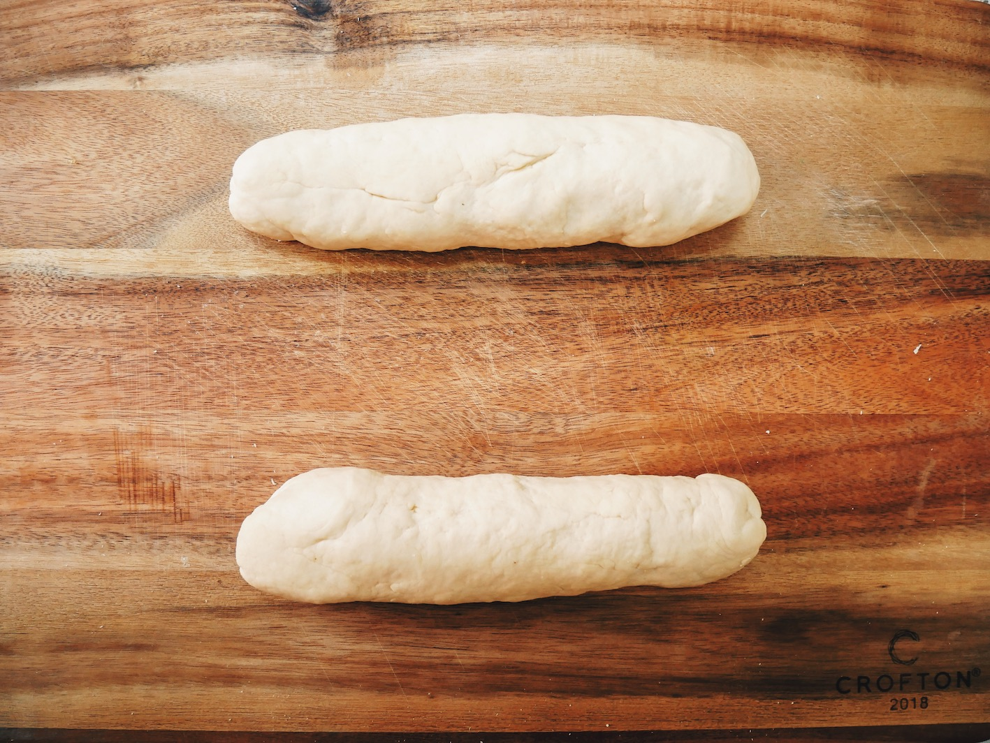 Step 5. Break dough into two equal sections.