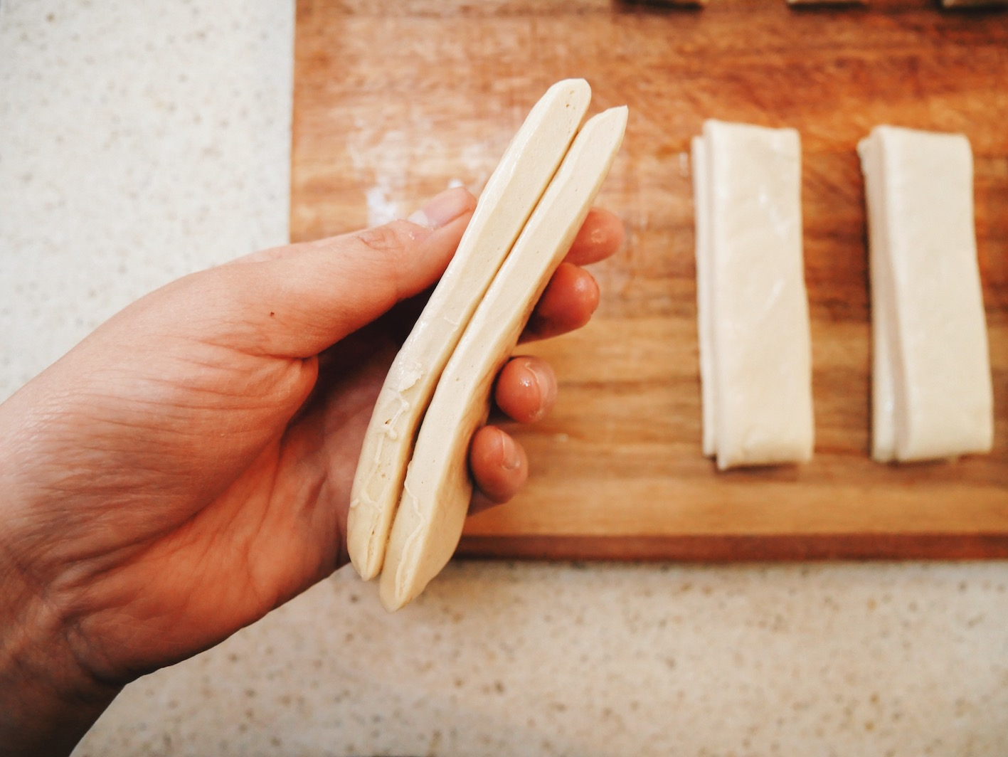 Step 8. Layer two strips of dough on top of each other.