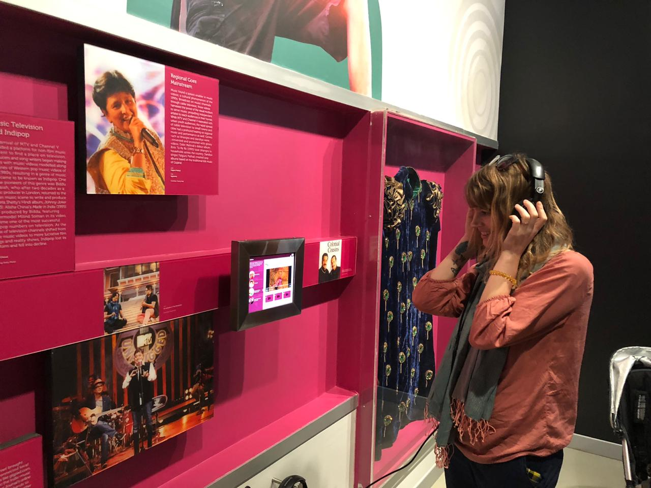 Laura listening at museum.jpeg