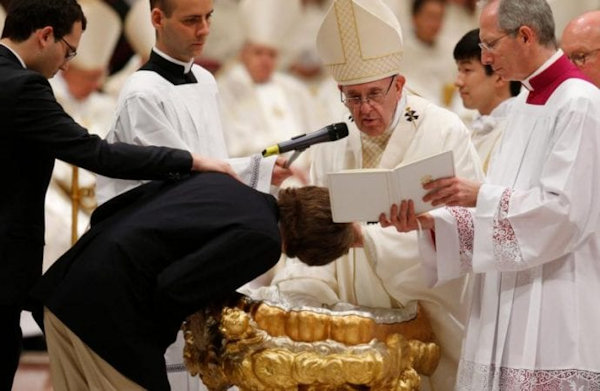Pope Francis conducting an adult baptism