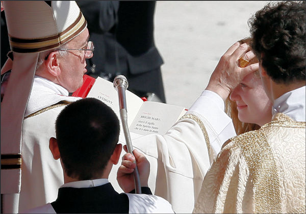 Pope Francis anointing in Sacrament of Confirmation