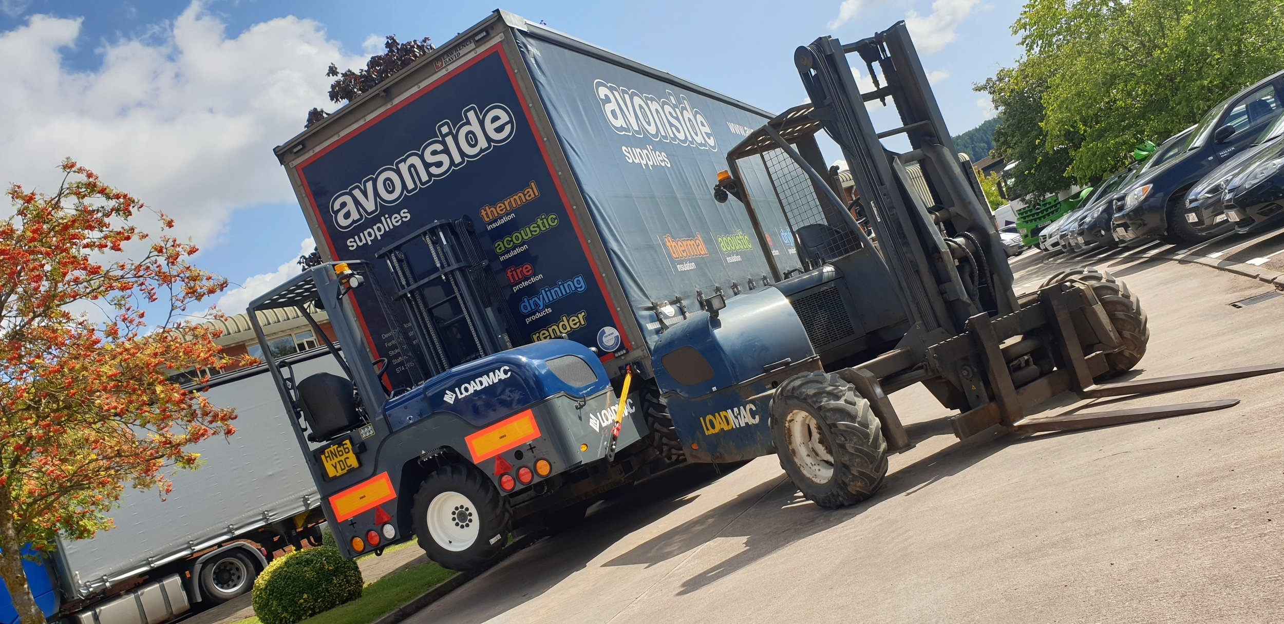 Number 1 (right) and Number 500 (left): Avonside Insulation Supplies take delivery of the 500th Loadmac 825 truck mounted forklift made in Britain.
