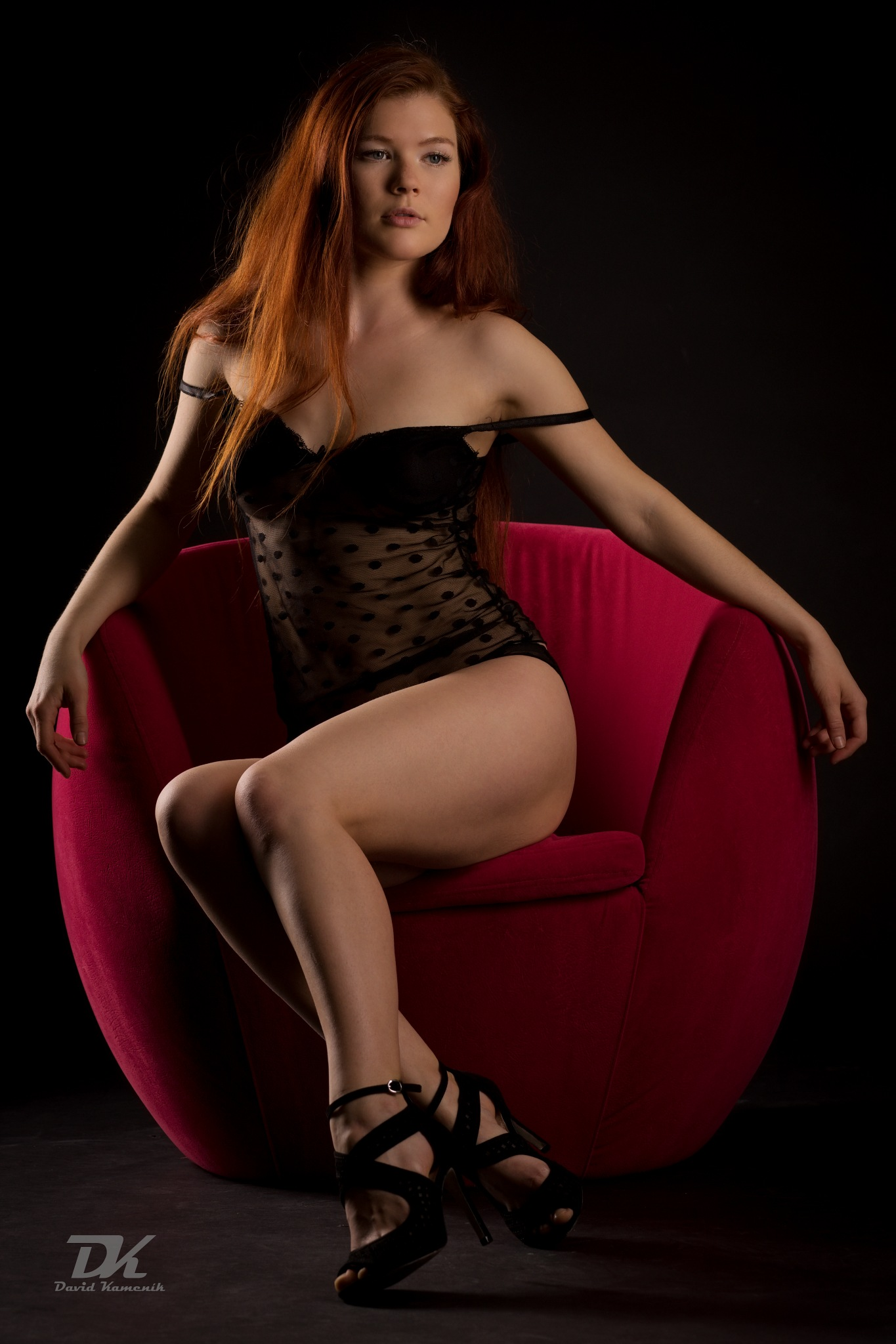 Lady in red chair