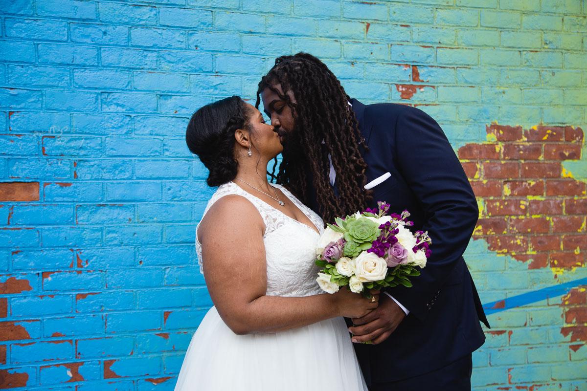 Elizabeth-Mealey-New-York-Wedding-Photographer-Black-Bride-Groom-Kiss-Blue-Brick-Wall-Brooklyn-9209.jpg