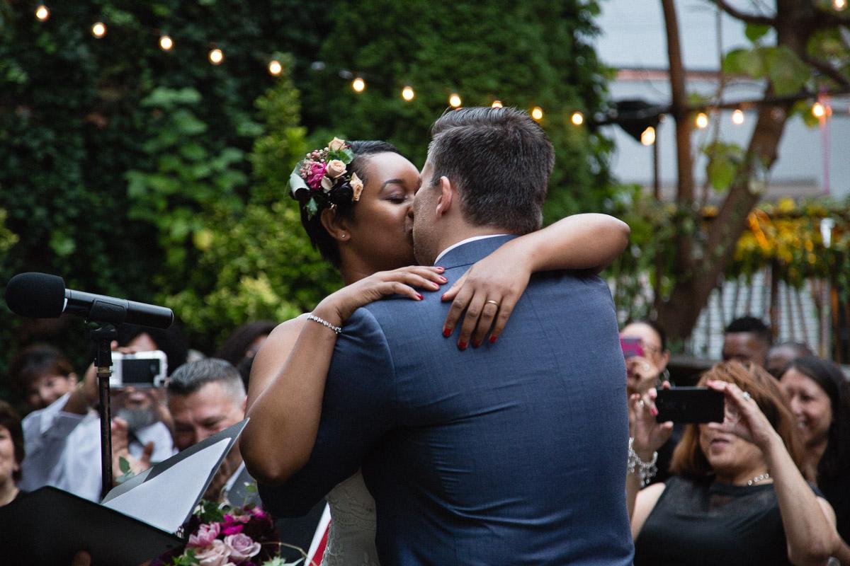 Elizabeth-Mealey-New-York-Wedding-Photographer-Black-Bride-Interracial-Couple-Kiss-Mymoon-Restaurant-Brooklyn-9994.jpg