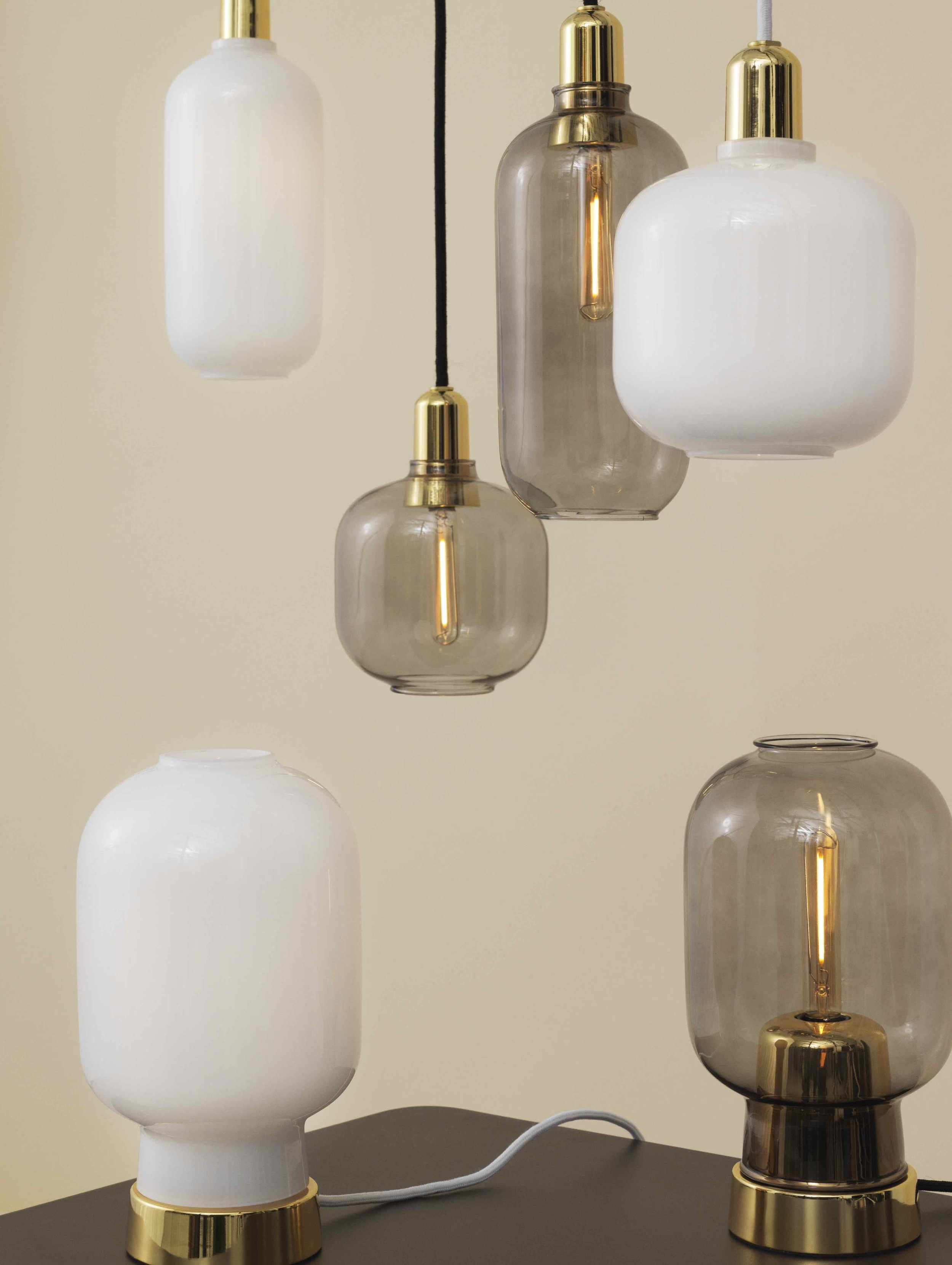 GOLDEN DETAILS - The popular Amp lamp family has grown by a new member. Now with a shinny and elegant look.