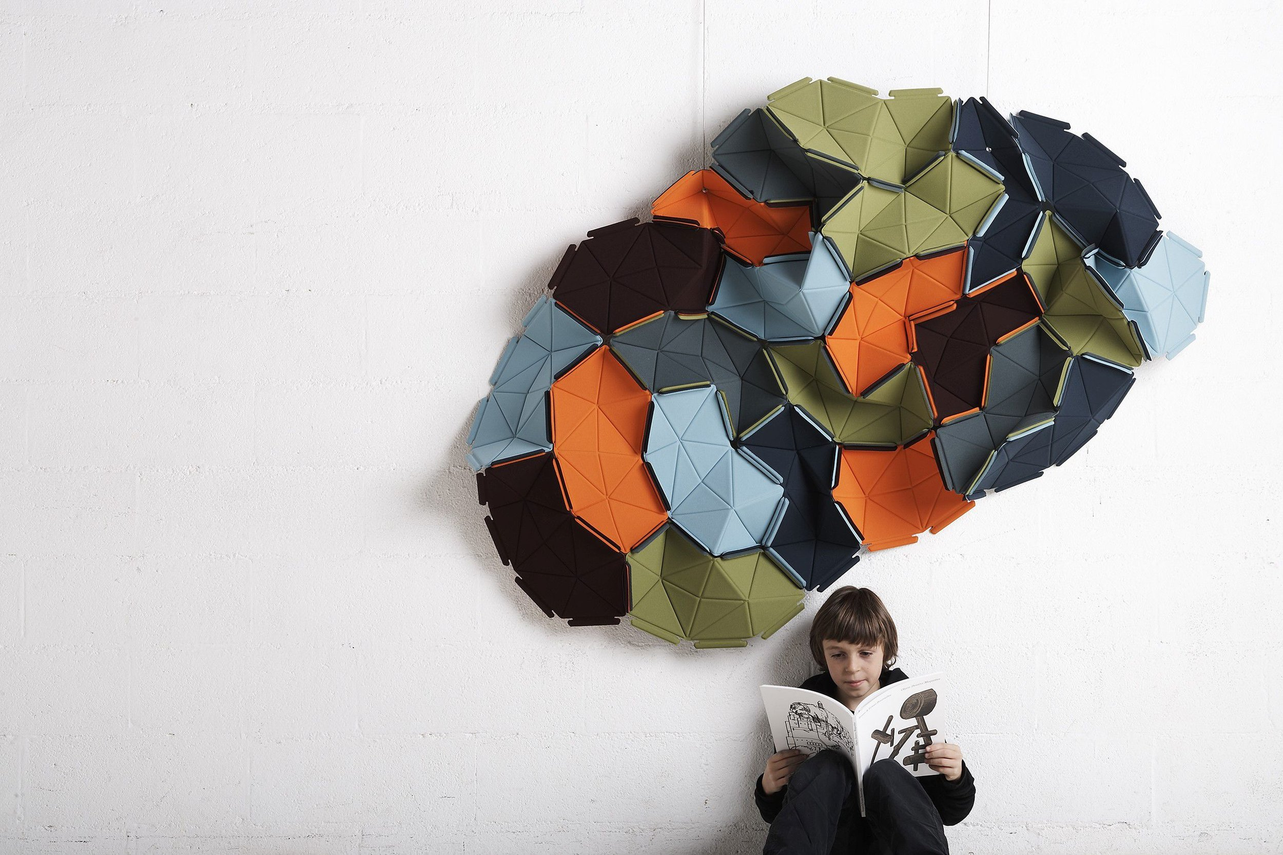 Ronan and Erwan Bouroullec created  Clouds  for   Kvadrat, an innovative, interlocking fabric tile concept for the home.  Clouds  can be used as an installation and be hung from a wall or ceiling. You can really create your own art pieces as big or small as you want.