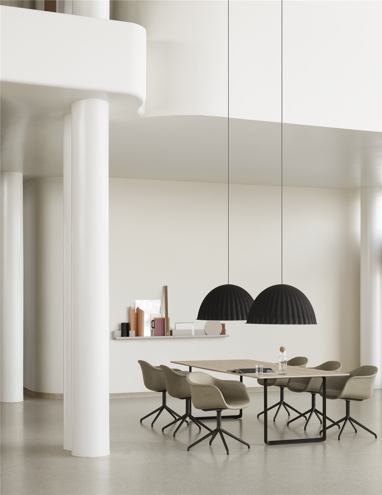 - Under The Bell is a pendant lamp that is multi-functional as the design not only provides an ambient light but also enhances the acoustics of the room. Under The Bell is a prime example of modern design with hints to Scandinavian values.