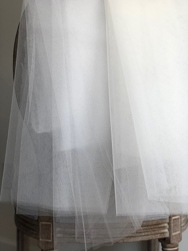 White tulle hues are brighter than warmer ivory tones.