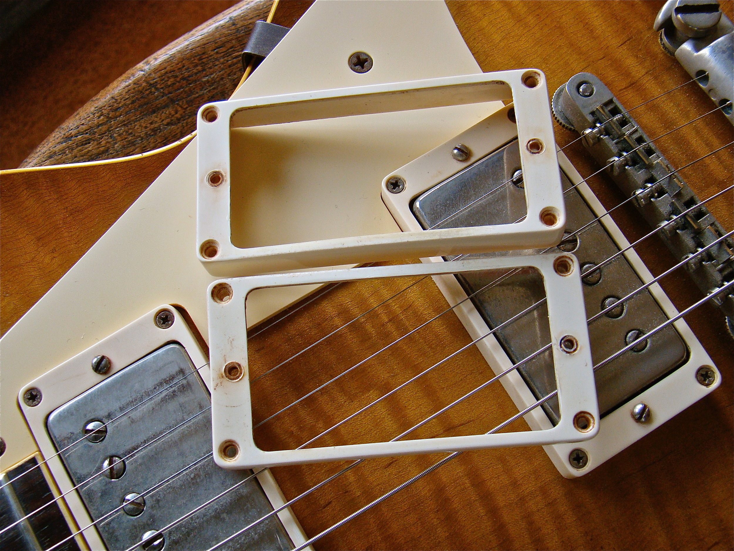 HUMBUCKER SURROUNDS  Exact replica M69 PAF humbucker surrounds. The famous 'Over the Pond'or 'English'rings. We are the originators of these rings. All 'OTP'rings come from Vintage Haven.Each pair comes with a set of period correct mounting screws.  £190 per pair