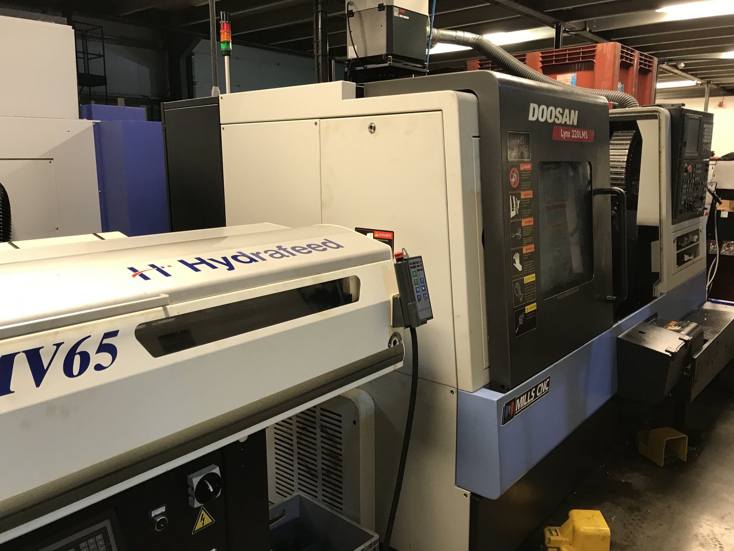 Doosan Lynx 220 Lathe - 65mm bar capacity driven tool lathe with automatic barfeeder and subspindle. High speed unmanned manufacturing of finished turned and milled parts from up to 65mm bar stock.We manufacture headsets, seat clamps and part finished blanks ready for the 5-axis machines.