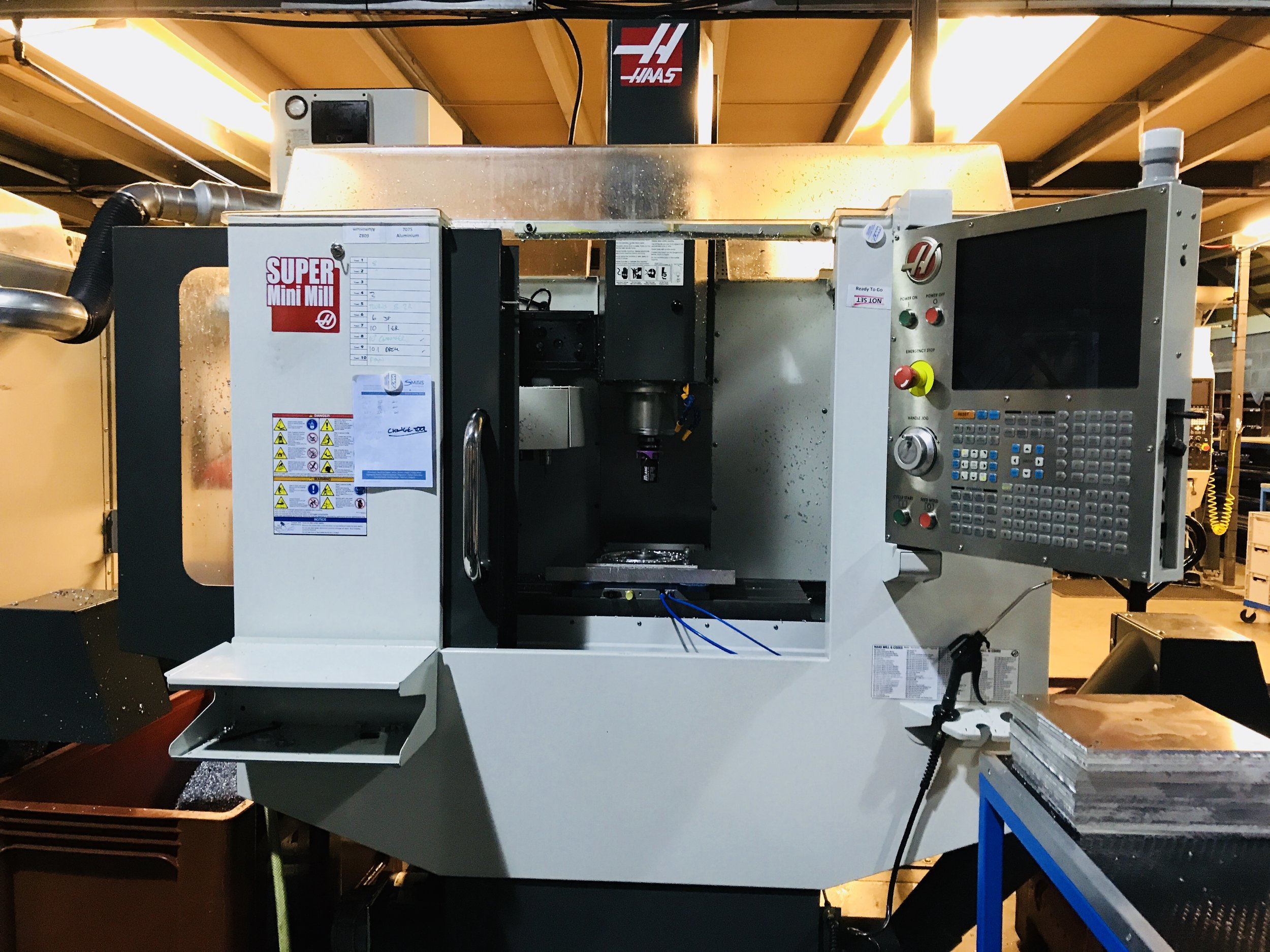 Haas Super Mini Mills - Two high speed 10,000RPM milling machine with vacuum loaded pallet system or zero point vices, for fast deployment of small run jobs. Most jobs do not justify investment in volume manufacturing tooling, so the small machining envelope suits this type of work.For smaller runs and flexibility to work around the schedule of the bigger machines. The Haas Super Minimills are as accurate as the larger machines and allow us to flex production to customers demands.