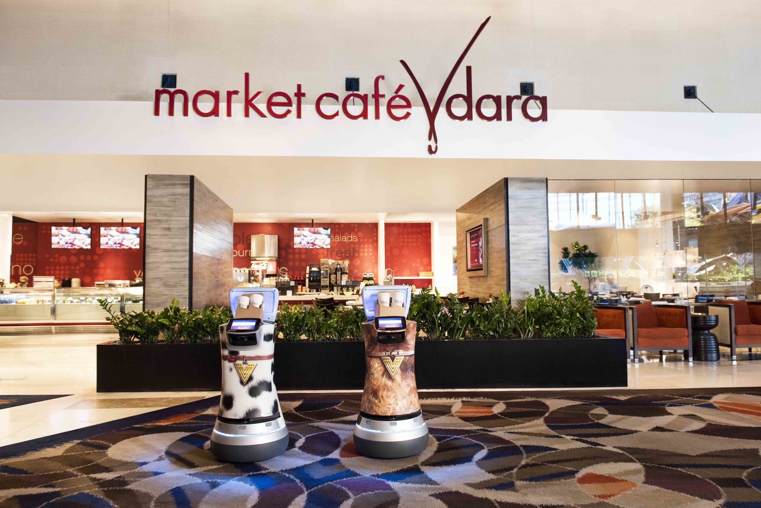 Robots, Fetch and Jett, are happy to deliver snacks and such directly to guests as they relax in their suites.