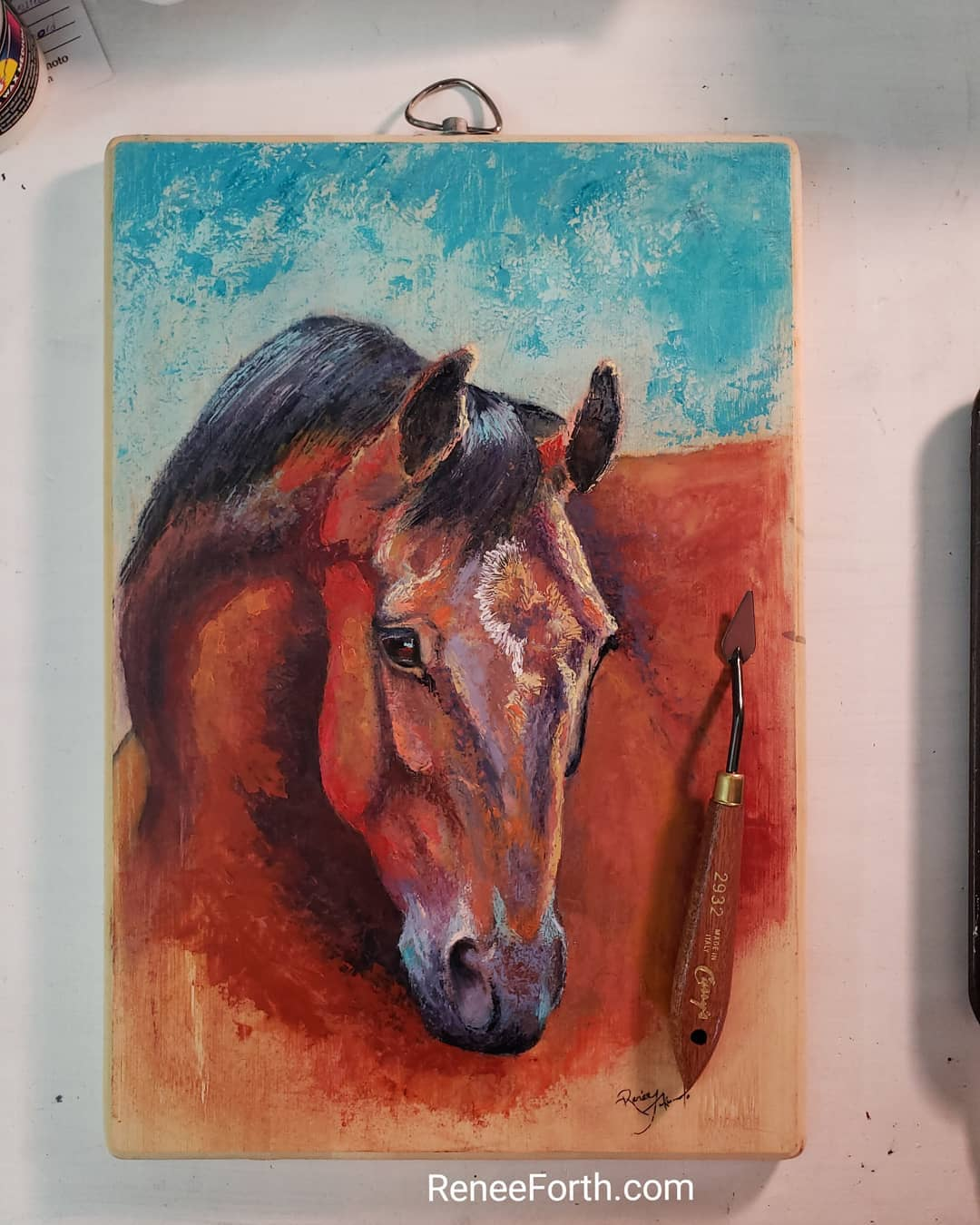 Bay horse portrait in oils, soft pastel and cold wax on bamboo cutting board Copyright artist Renee Forth-Fukumoto