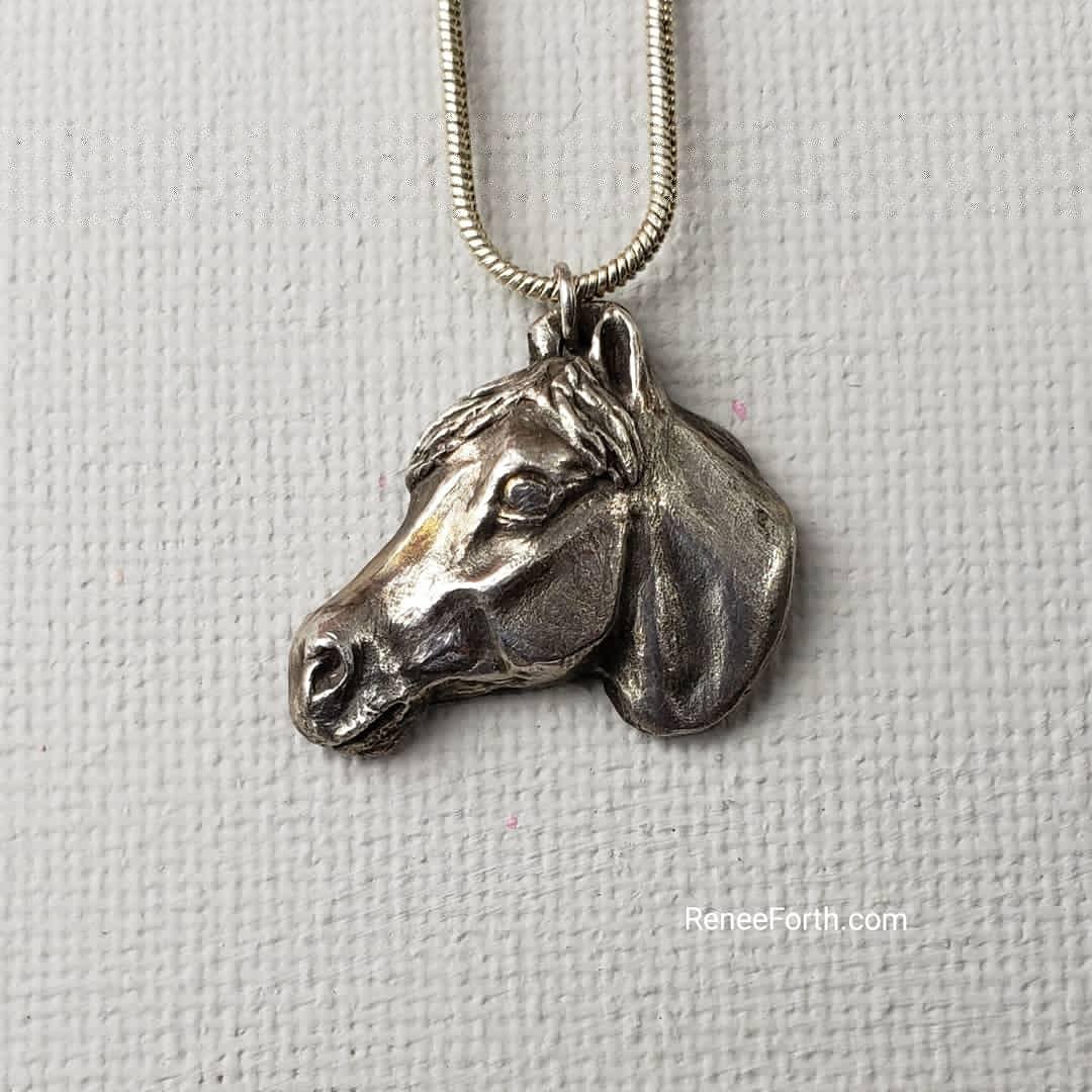 Custom Sculpted Fine Silver horse head pendant. Copyright Renee Forth-Fukumoto.