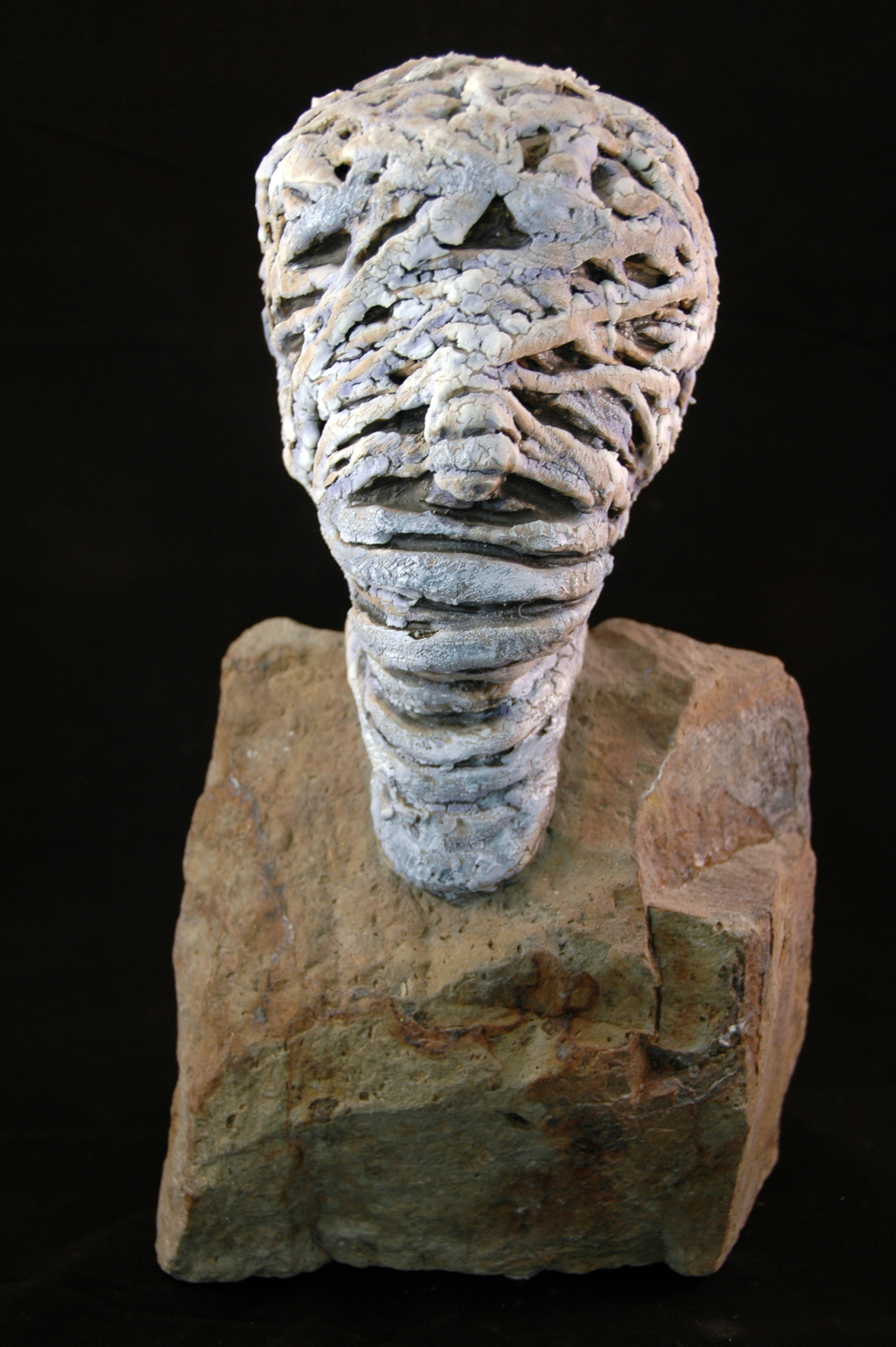 Wrapped Head on a Rock