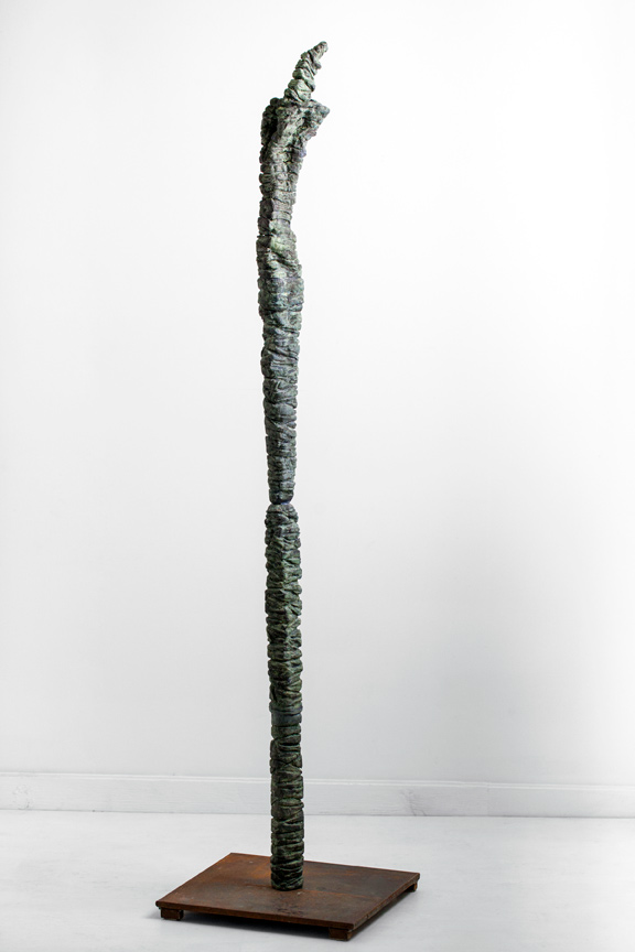 Tall Green Figure