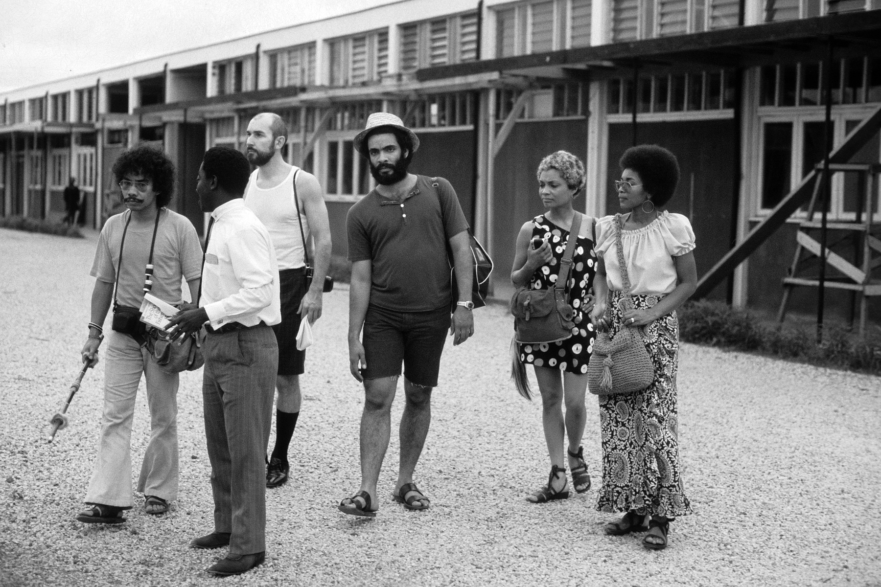 This photo, taken in front of the Kwame Nkrumah University of Science and Technology (KNUST) Department of Architecture in Kumasi shows some of the Kinne Award recipients during the Ghana trip. In addition to KNUST, the group toured the city of Accra, a slave castle, and various projects Max Bond had designed for the government, most notably the Bolgatanga Regional Library.  Left to right : Lloyd de Suze, Ghanaian professor, School of Architecture student, David Kirkwood, Sharon Egretta Sutton, and Marva Britt. Photo courtesy of Stanford R. Britt