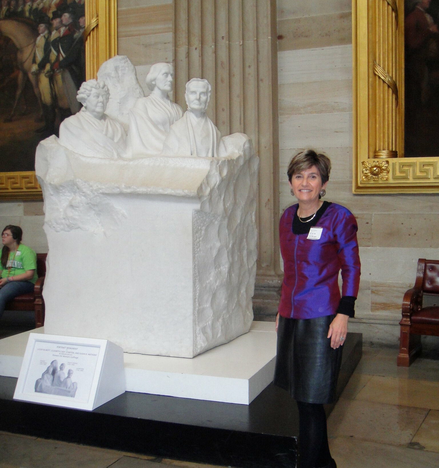 Kathryn Anthony with the group portrait monument to the pioneers of the woman suffrage movement at the US Capitol.