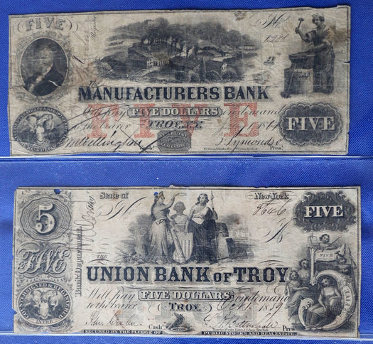 """A few """"obsolete notes"""" from Troy from the first half of the 19th century. / photo courtesy of Ferris Coin Co."""