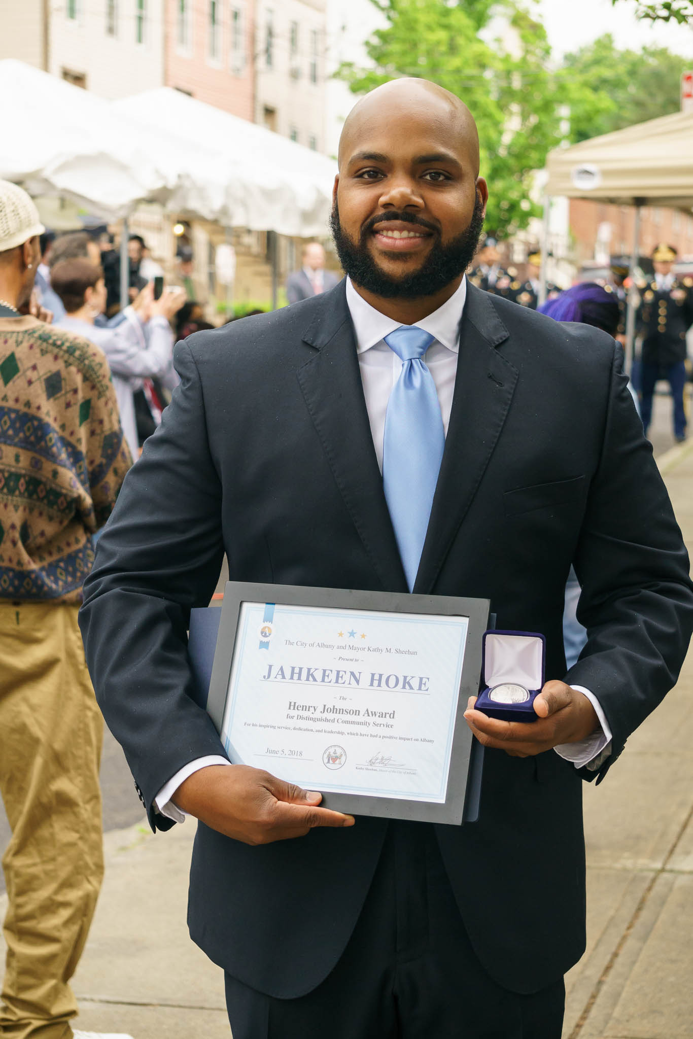 "Jahkeen Hoke, winner of the second annual Henry Johnson Award for Distinguished Community Service, received a silver commemorative Sgt. Henry Johnson medal along with a certificate and a monetary reward. See:  ""Albany marks 2nd Annual Henry Johnson Day,""  Times Union,  June 5, 2018."