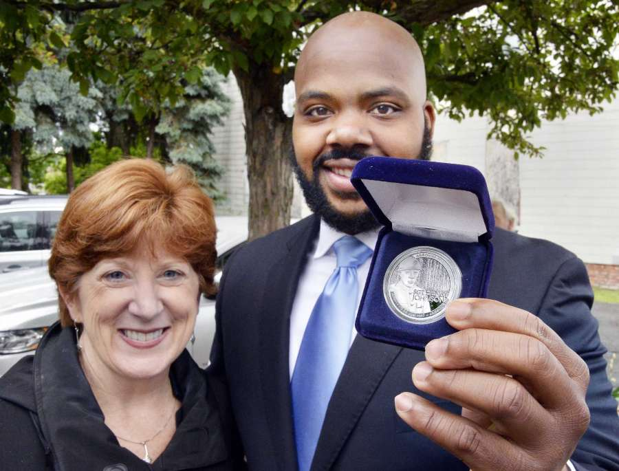 J ahkeen Hoke, right, of 4th Family Inc. poses with Mayor Kathy Sheehan and his Henry Johnson Award for Distinguished Community Service during the 2nd Annual Henry Johnson Day observance Tuesday June 5, 2018 in Albany, NY. (John Carl D'Annibale/Times Union)  Buy photo