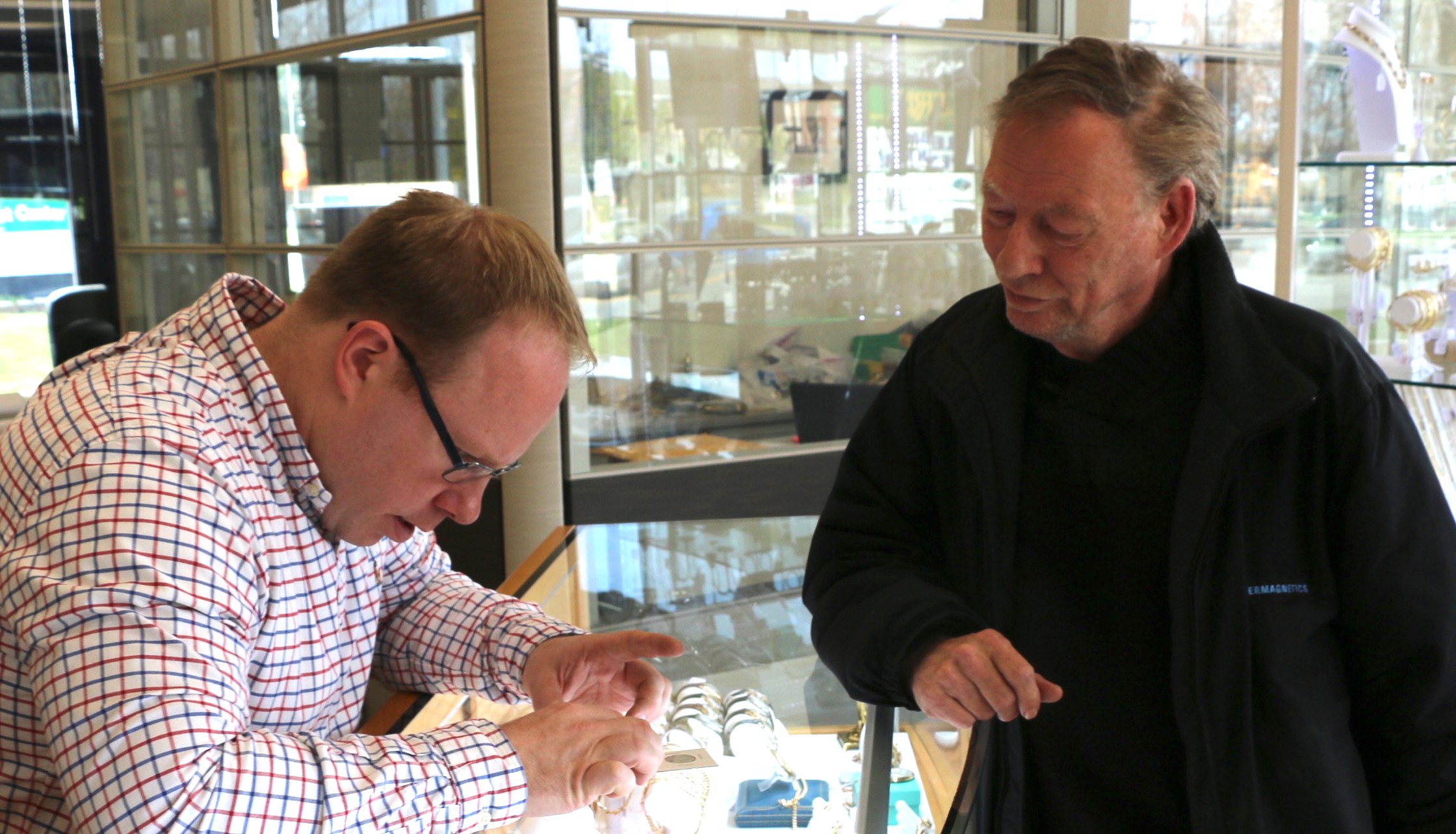 Dozois inspects the first 2019-W Quarter to arrive at Ferris Coin & Jewelry Co., at 199 Wolf Road.