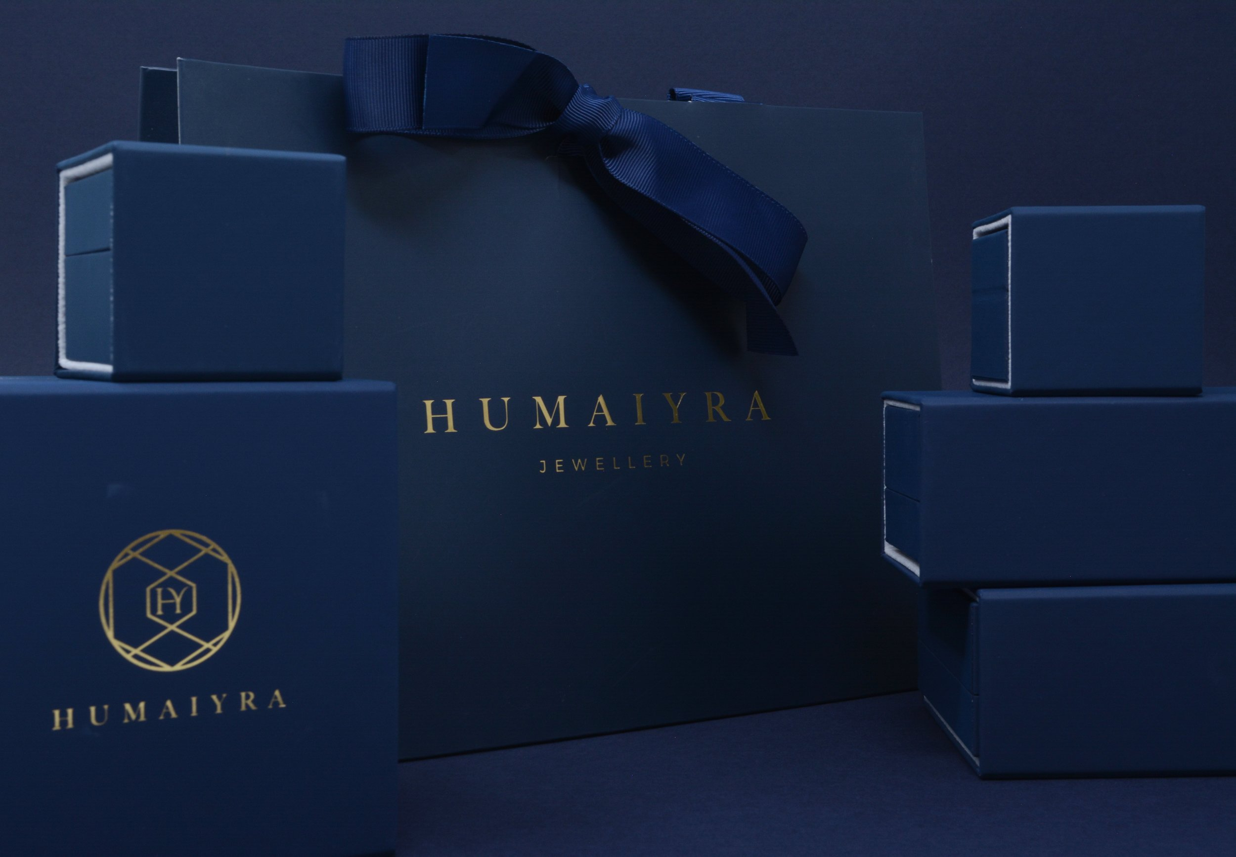 The Perfect Gift - Nestled inside through the layers, you will find our signature rich blue jewellery box holding your jewels and a complimentary gift bag, a complete customer experience.