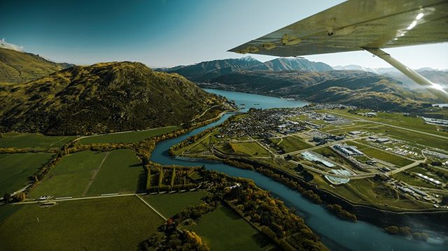 Views from the air in New Zealand 😍📷 . Happy Friday everyone. Double tap ❤️ if you've got weekend plans. . An aerial photo of a town in New Zealand with a gemstone river running through it. The grass and the mountains are green and gold with bare snow top mountains in the background. The wing of a 7 passenger plane is in the foreground. . #plane #smallplane #adventure #flight #roadtrip #newzealand #milfordsound #glenorchy #glenorchyair #southisland #hike #camp #roadtrip #beautiful #landscape #town #green #sunset