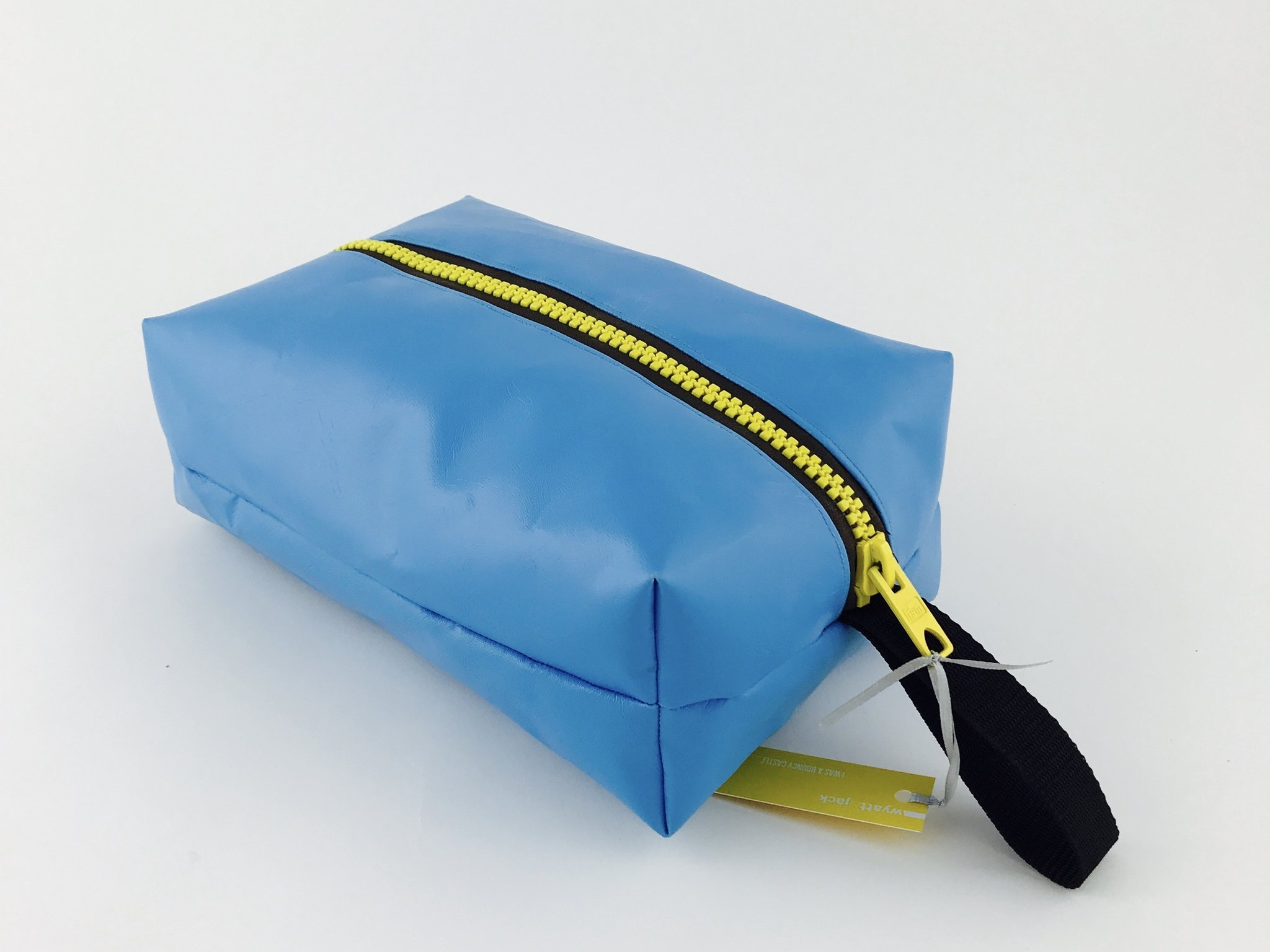Box Wash Bag - A wash proof neon kite or black cotton lining, a contrasting full zip closure and webbing strap, for hanging up behind doors of swanky hotel roomsLarge enough for a full size bottle of shampoo and all your essential bits n bobsDimensions: L 350mm x W 230mm x D 160mm