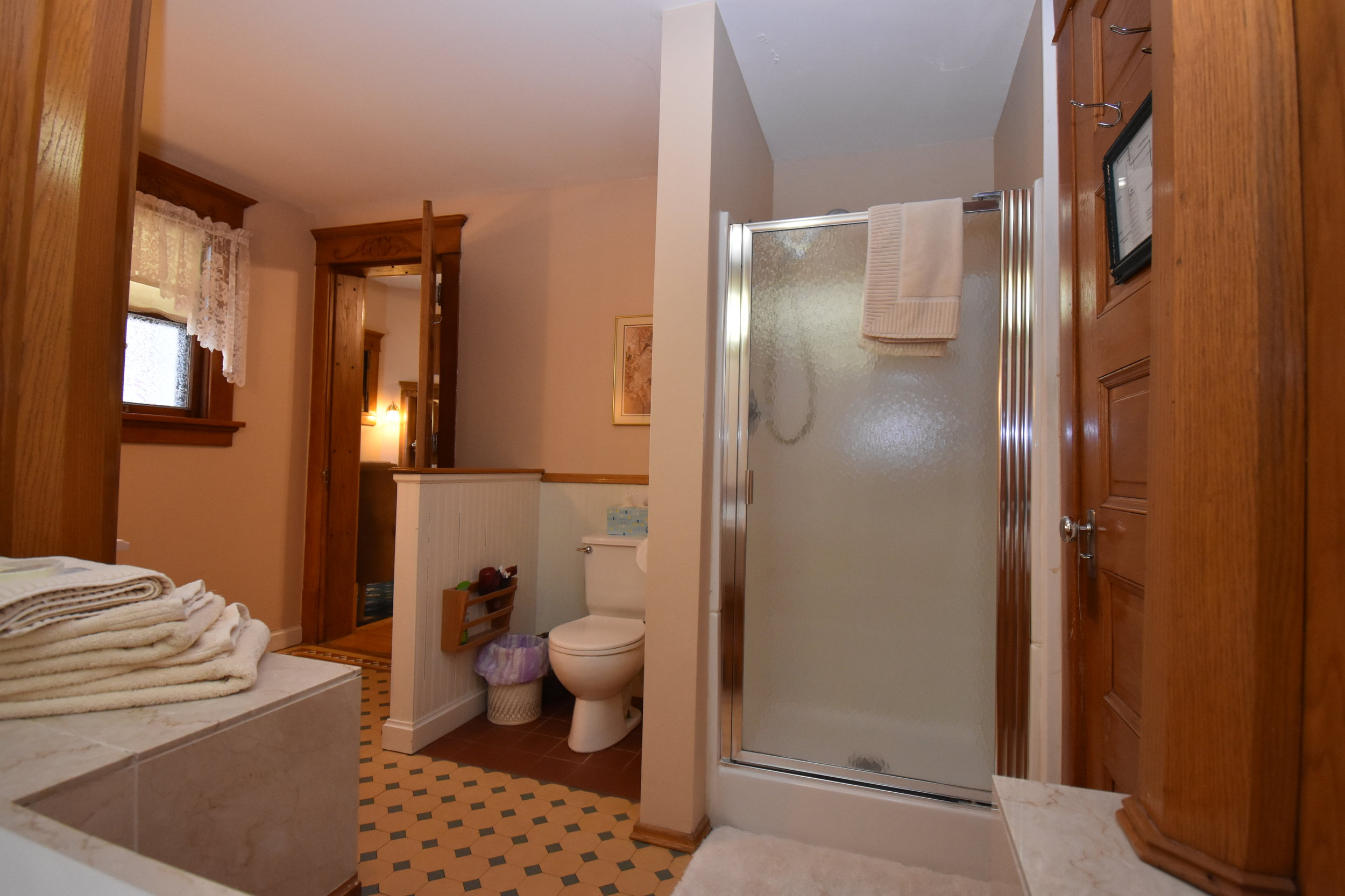 Private bathroom with separate shower