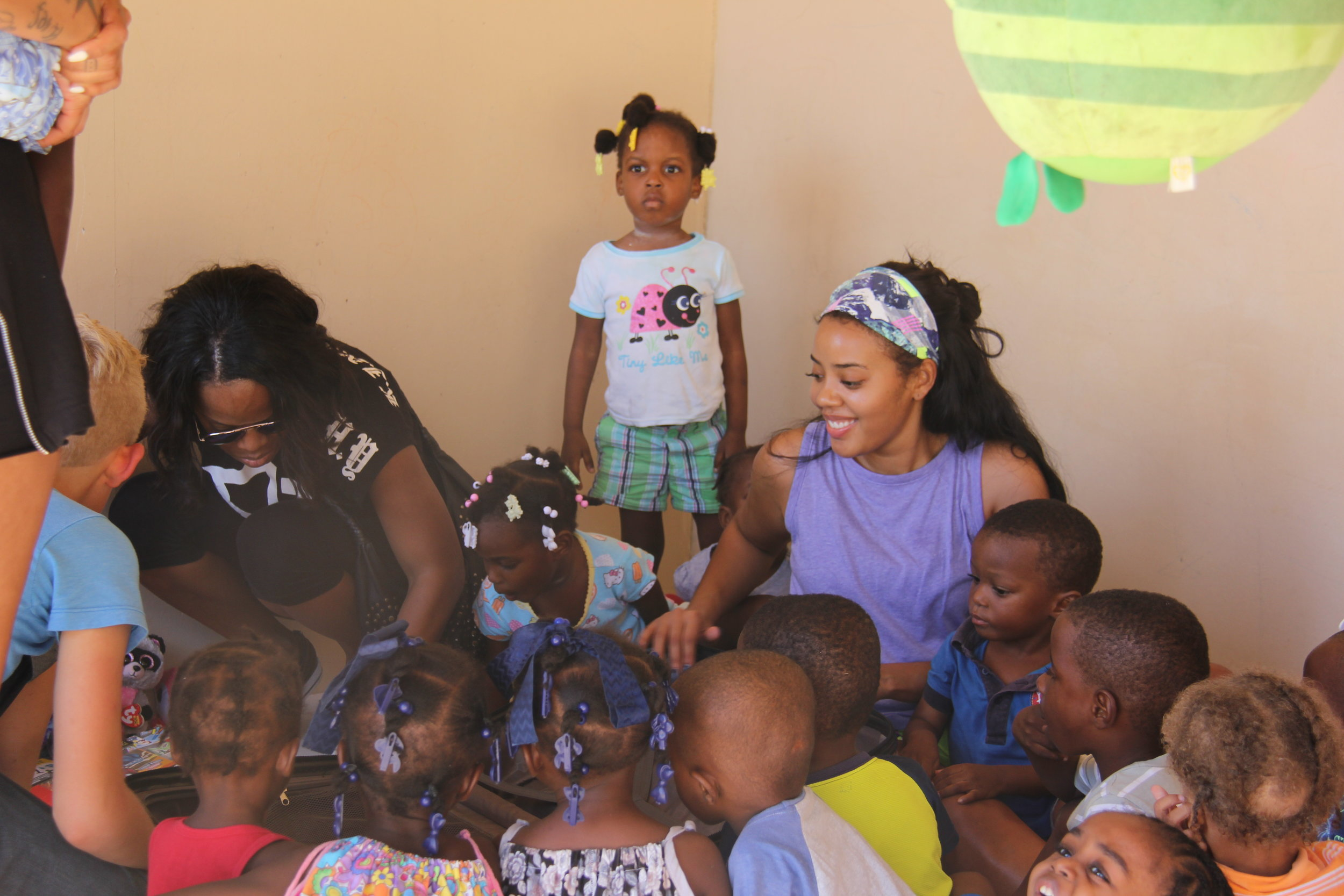Pictured: Global Influencer, Angela Simmons, serving and engaging with youth at the Children of Grace Orphanage.