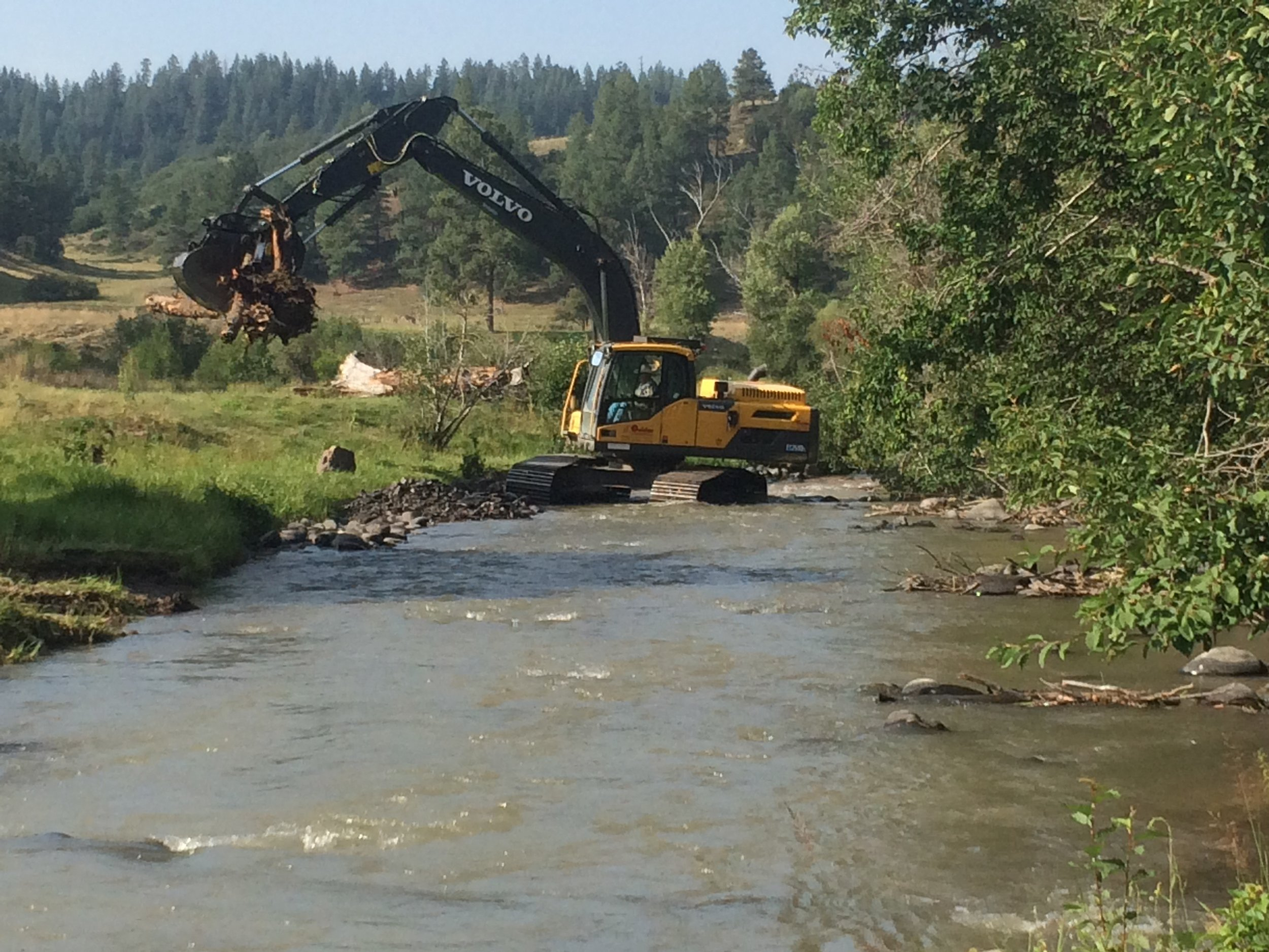 Restoration work on the Navajo River to stabilize banks and improve stream habitat. The channel of the Navajo River was strongly affected by loss of water volume downstream of the Oso Diversion, a Bureau of Reclamation project that moves water from San Juan river tributaries under the Continental Divide into the Rio Chama and hence the Rio Grande basins.