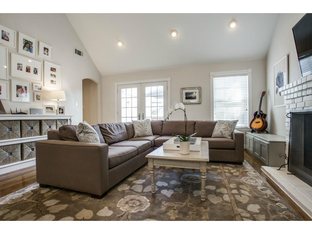Using the homeowner's guitar as decor coupled with the gallery wall of personal photographs showcases their personalities.